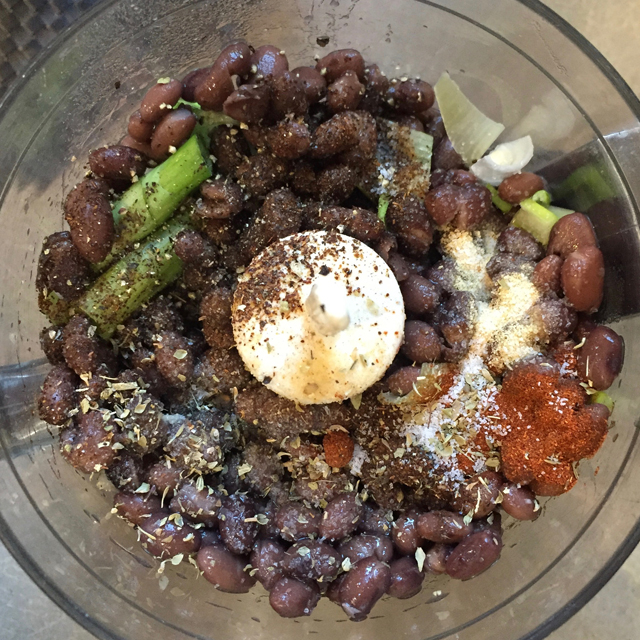 Black beans and other ingredients in the food processor.