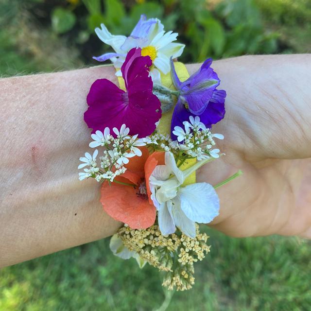 Wrist adorned with finished flower petal bracelet.