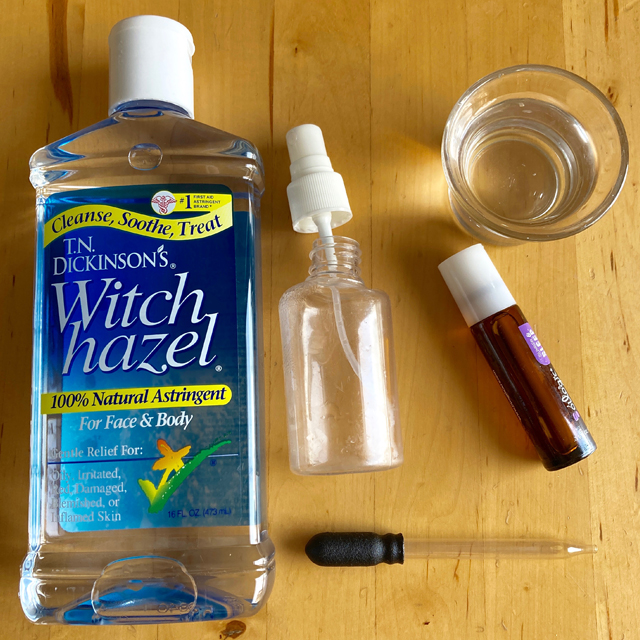 Container of witch hazel, spray bottle, and medicine dropper.