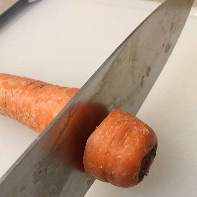cutting top off a carrot