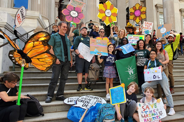 BBG staff and their families with signs at the Global Climate Strike.
