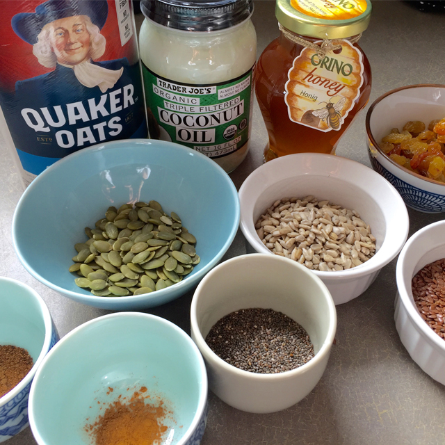 ingredients for granola (oats, seeds, honey, spices)