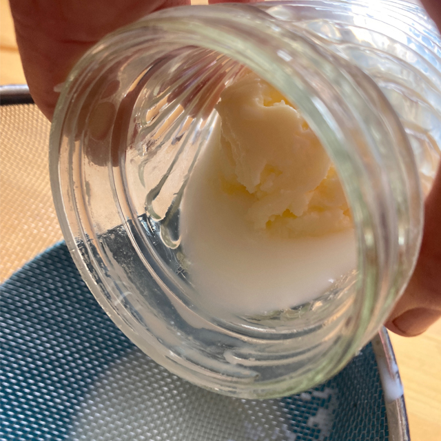 Pouring buttermilk into a bowl, with remaining butter in a jar.