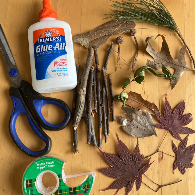 Scissors, glue, tape, and natural materials (leaves, sticks, acorn tops)