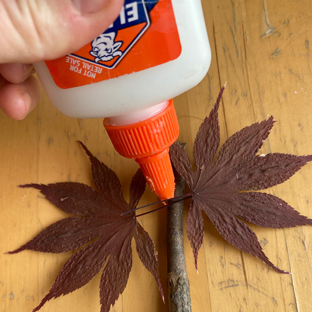 Glue being used to make craft.