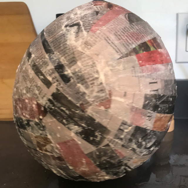 Paper mache on a balloon.