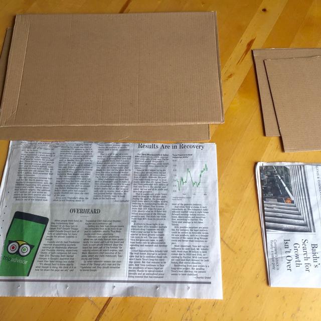 Newspaper and cardboard.