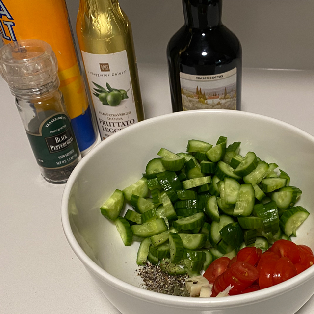 Chopped cucumber and tomato in a bowl.