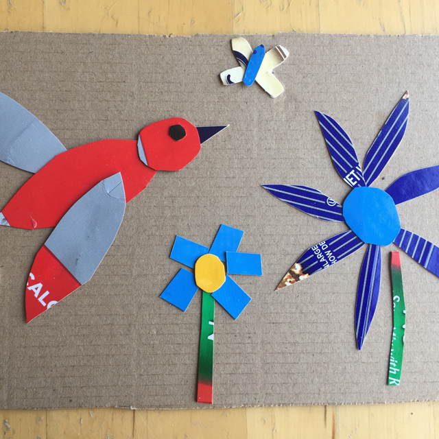 Art made with recycled materials (bird and flowers).