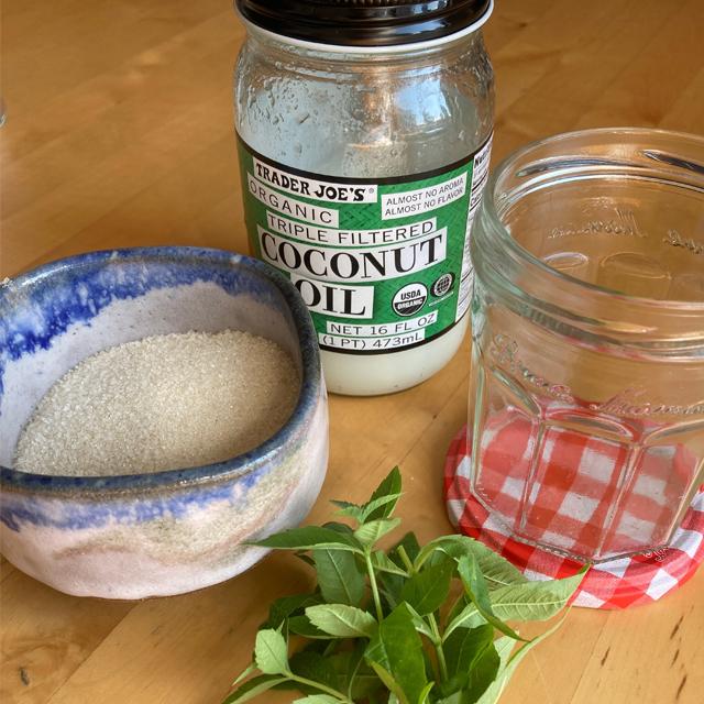Sugar, coconut oil, fresh herbs and a jar.