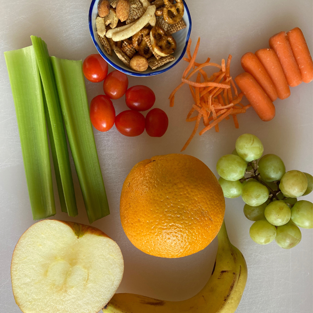 Fruits and vegetables (orange, apple, grapes, carrots, and celery.