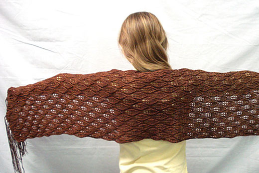 Girl in a brown knitted shawl