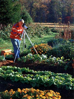 Walter Chandoha taking photographs in his garden.