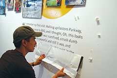 Manny Jose, Graphic Designer extraordinaire, burnishes Garden memory quotes on to the Steinhardt Gallery walls.